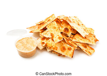 Stack of salted crackers isolated on white background.