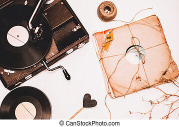 Stack of scratched dusty old vinyl records tied with rope