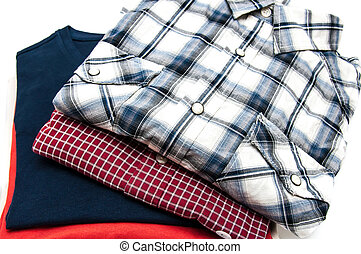 Stack of Shirts and T Shirts in different colors isolated on...