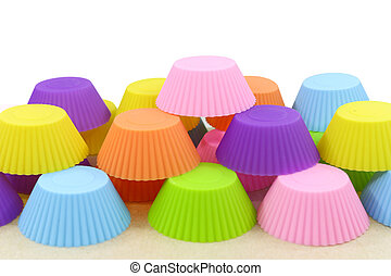 stack of silicone colorful cupcake molds