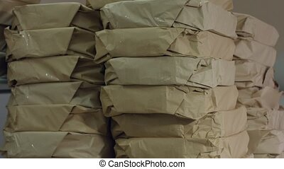 Stack of simple paper packages.