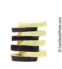 Stack of slices black eggplant.