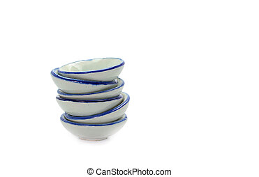 Stack of small bowls on white background