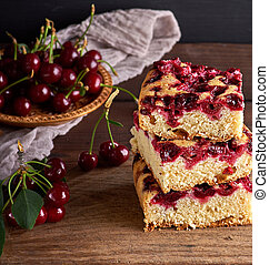 stack of square slices of a baked pie with cherry berries
