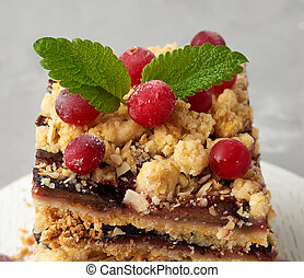stack of square slices of baked crumble pie with blue plum