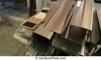 Stack of steel parts. Smooth metal surface.