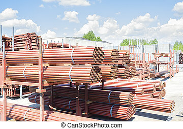 Stack of steel pipes for scaffolding in stock.
