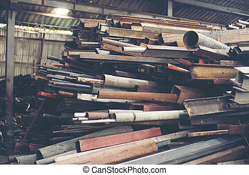 Stack of steel pipes in metal factory shop