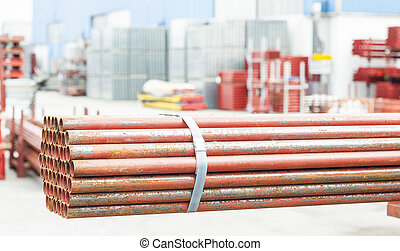 Stack of steel tubes in stock.