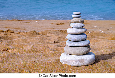 Stack of stones on sea beach