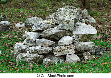 Stack of stones on the grass