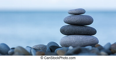 Stack of stones - Stack of round smooth stones on a seashore