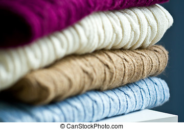 Stack of sweaters - Stack of folded cable knit sweaters