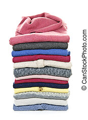 Stack of sweaters - Stack of warm sweaters isolated on white...