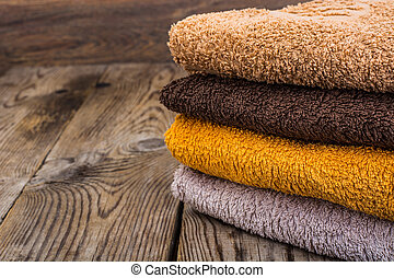 Stack of terry towels on wooden table