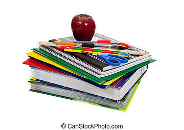 stack of textbooks with school supplies on top