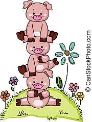 Stack of three little piggies in garden with flowers