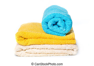 stack of towels isolated on white background.
