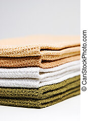 Stack of kitchen towels. Shallow DOF with focus on the corners. Space above and below for text.