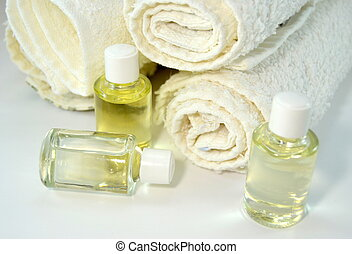 Stack of towels with skin oils