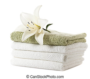 stack of towels with white lily on white background