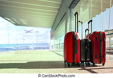 stack of traveling luggage in airport terminal and passenger...