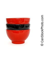 Stack of two red and one black porcelain bowls isolated