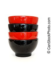 Stack of two red and two black porcelain bowls isolated