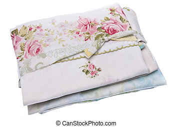 Stack of vintage fabric isolated on white with a clipping path.