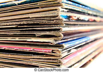 Stack of old vinyl records in traditional and colorful cardboard covers