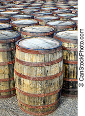 Stack of whisky casks and barrels - Horizontal detail of ...