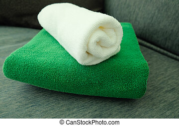 Stack of white and green clean towels