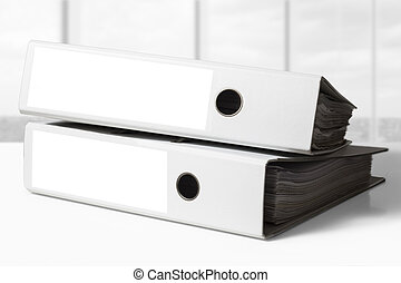 stack of white business binders
