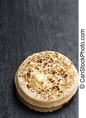 Stack of wholemeal crumpets isolated on the table