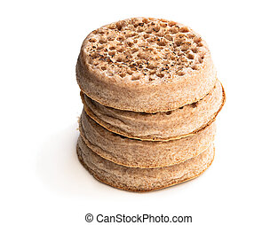 Stack of wholemeal crumpets isolated on white background