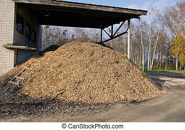 Biomass fuels. Chipped wood. Natural fuels. - Stack of wood...