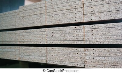 Stack of wood particleboard boards on the warehouse or...