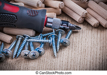 Stack of wooden dowel pins steel nails and insulated ...