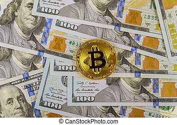 Stack one hundred dollar bills with Golden Bitcoin on US dollars digital currency