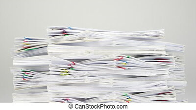 Stack overload document on white table time lapse - Stack...
