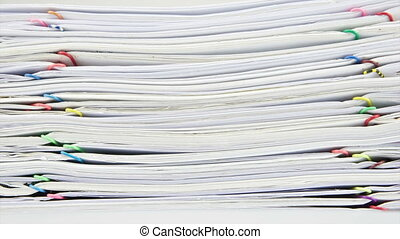 Stack paper and coins with house on - Stack old paper report...