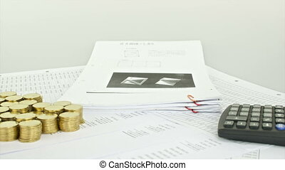 Stack paperwork and pile of coins w - Stack old paperwork...