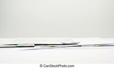 Stack paperwork report on table tim - Stack paperwork report...