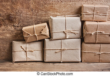 stack parcel in warehouse - pile parcel wrapped with brown ...