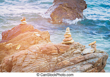 Stack rock on sea beach, natural abstract background