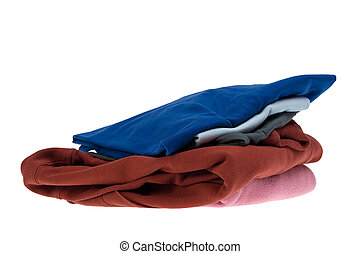 Stack shirts isolated on white