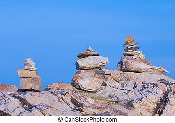 Stack stones with clear blue sky
