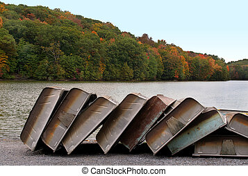 Stacked Boats in Autumn