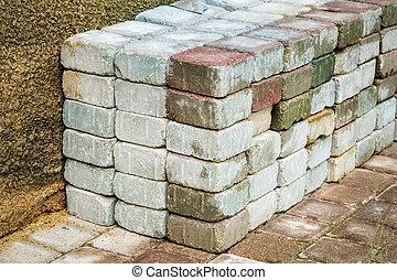 Stacked bricks near the wall