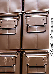 brown ammunition boxes - stacked brown ammunition boxes...